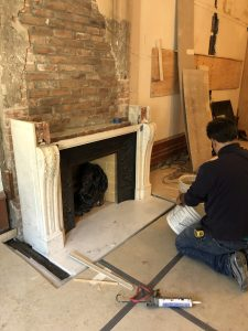 Antique marble mantel installation in brooklyn townhouse
