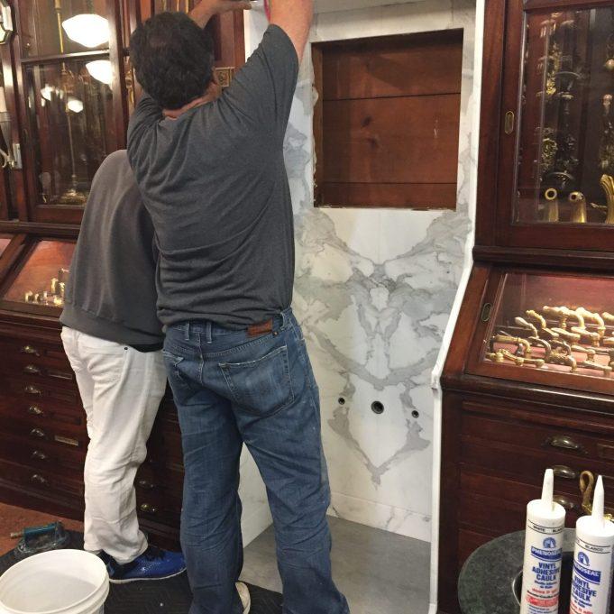 PE Guerin calacatta white marble sink niche installation