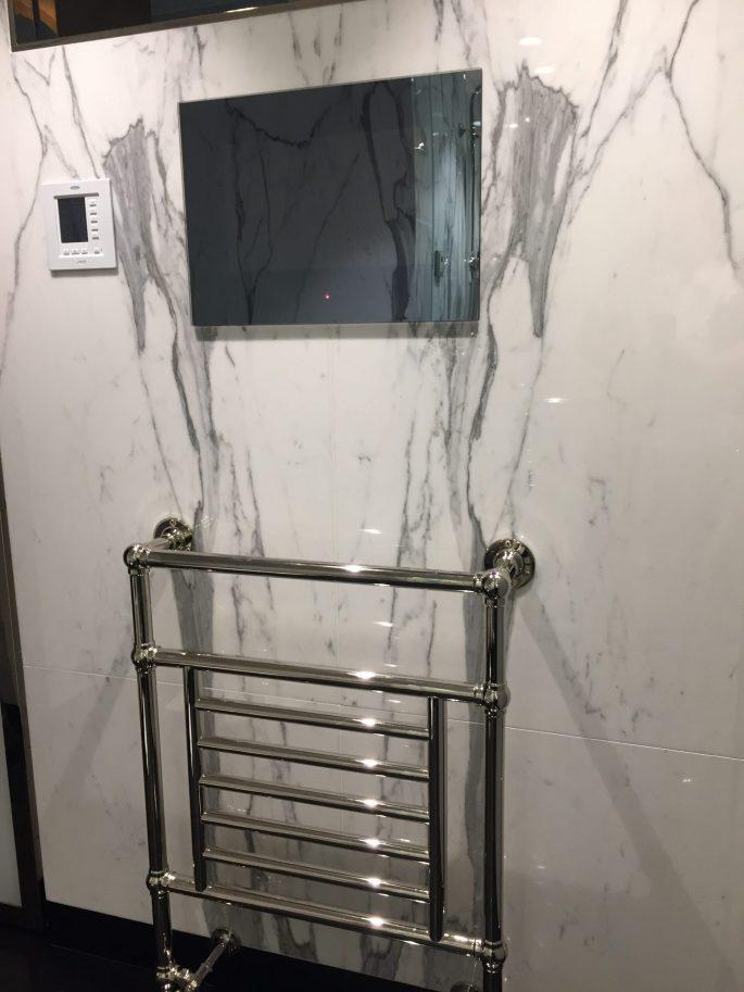 Master bathroom calacatta marble slab walls
