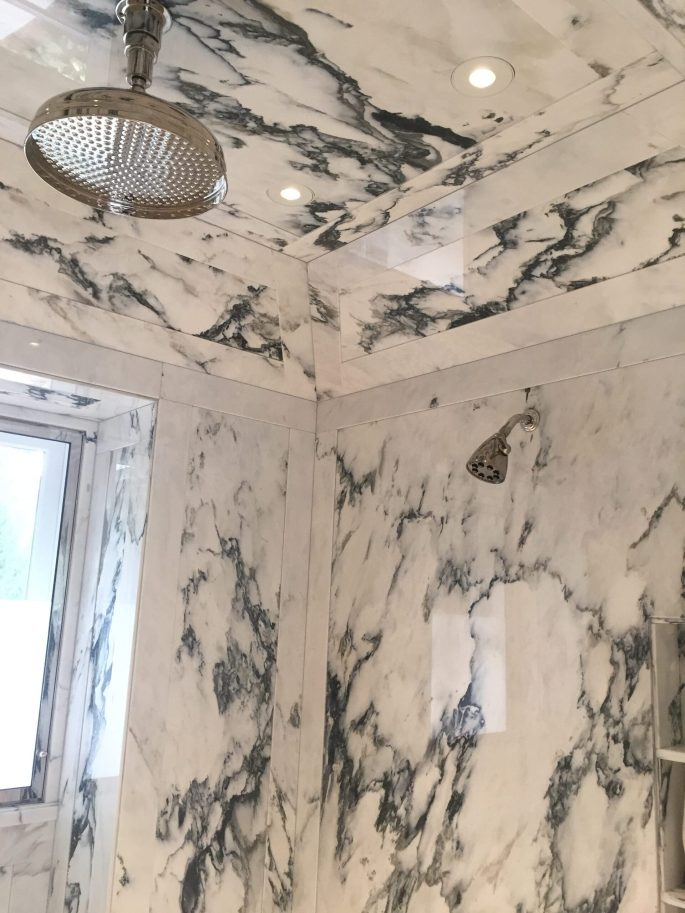 Paneled shower walls and ceiling in paonazzo white marble