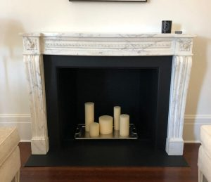 Antique white marble fireplace mantel