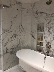 Master bathroom in calacatta marble slab