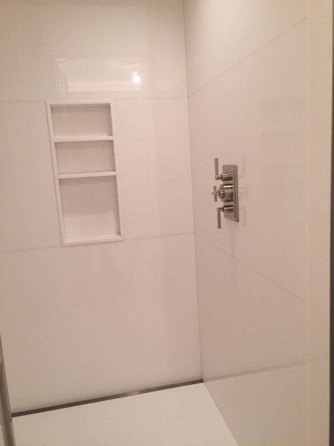 Master bathroom shower in white thassos slab