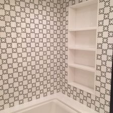 Master bathroom with custom belgium black and white thassos checkerboard mosaic