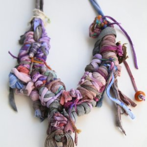 Title: Sojourn Violet Medium: Hand dyed cotton, yarn, upcycled costume beads Size: 36''