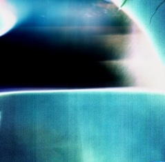 "Leo Hylan Title: Arctic Eclipse Medium: Digitally Enhanced Holga Photography Size: 16""x16"""