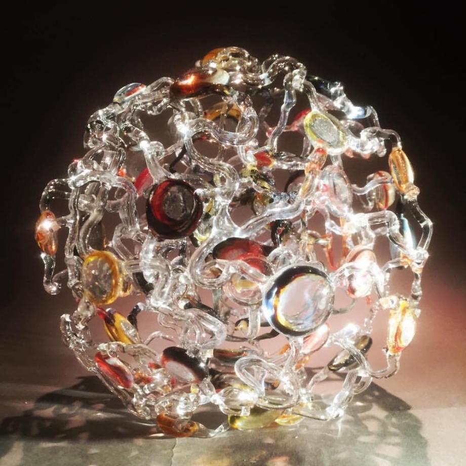 "Title: Wound Lens Medium: Borosilicate Glass Size: 12"" W x 12""L x 12""H"