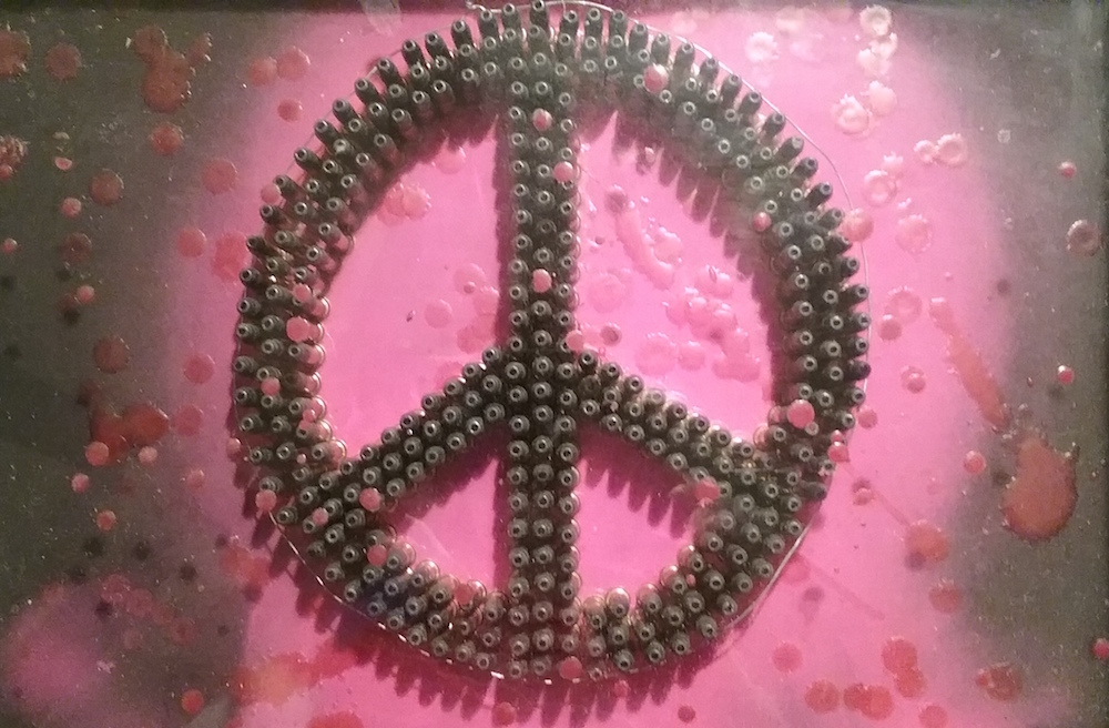 "Title: we must have Peace Medium: shadow box, wax, bullets Size: 11""x14"""