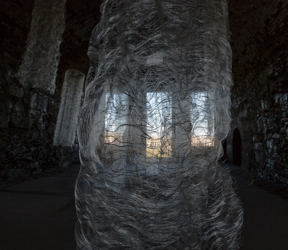 Title: 12 Memoirs Medium: Monofilament, Reflective yarn Size: Site-specific Installation at Fort Adams, New Port, RI