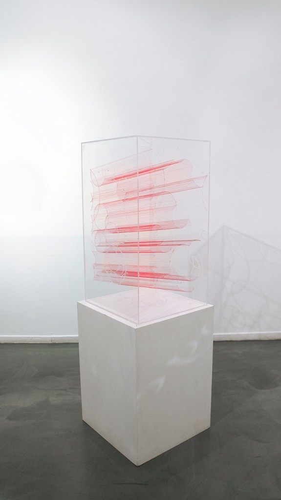 "Title:Slice of Time Medium:	Plexiglass acrylic Sheets and red thread Size:	17""W x 42""H x 18""L"