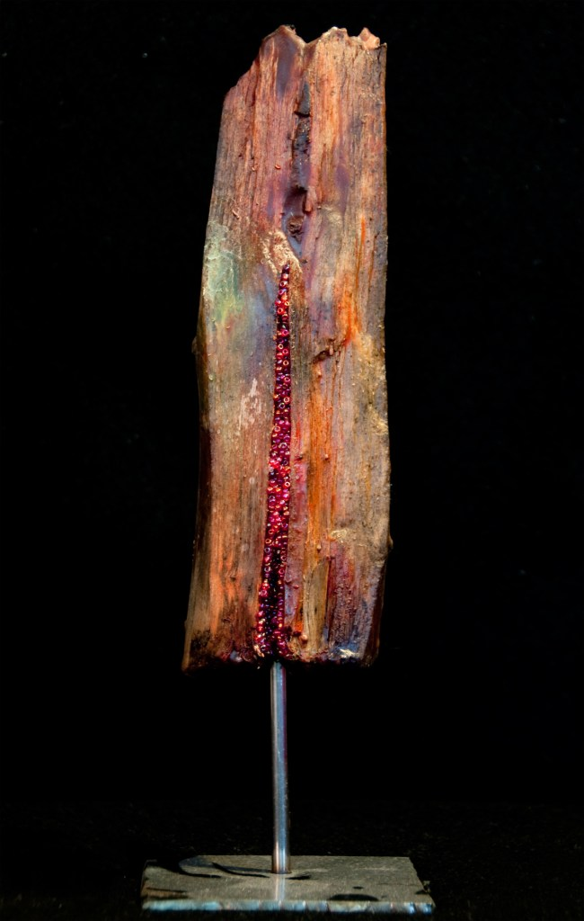 "Title Sensuality Medium Mixed Media: Driftwood, encaustic, beads, metal Size 11""X3.5""X3.5"""