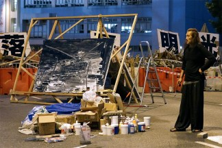 Miso Zo: Umbrella Movement (with a painting of barricades)