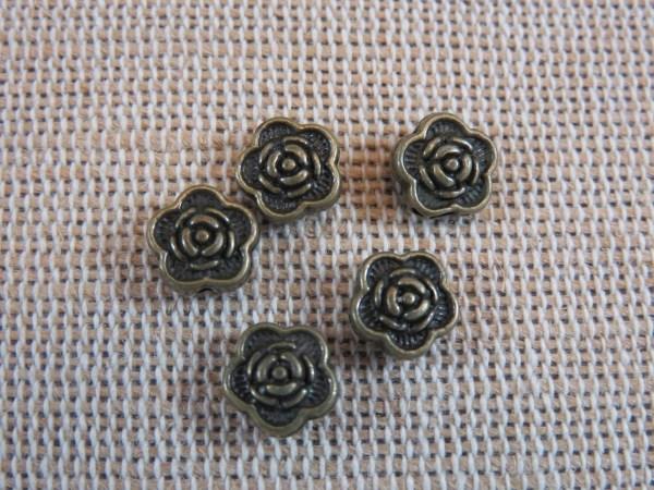 Perles fleur gravé bronze 7mm intercalaire - lot de 25