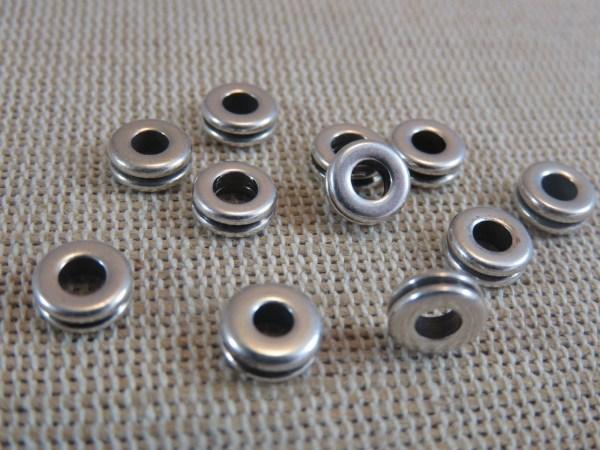 Perles donuts argenté 6mm plate haltère en métal - lot de 20