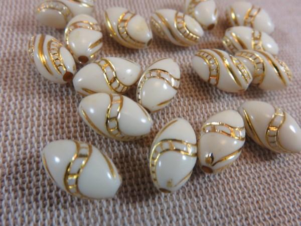 Perles ovale crème doré 13mmx8mm en acrylique - lot de 15