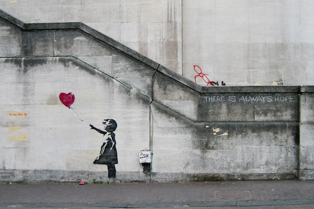 Banksy's Girl with Balloon graffiti artwork.