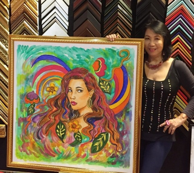 ginny-with-the-center-piece-of-her-art-exhibit-the-biggest-one%2c-done-in-acrylic-on-a-36-x-36-canvas