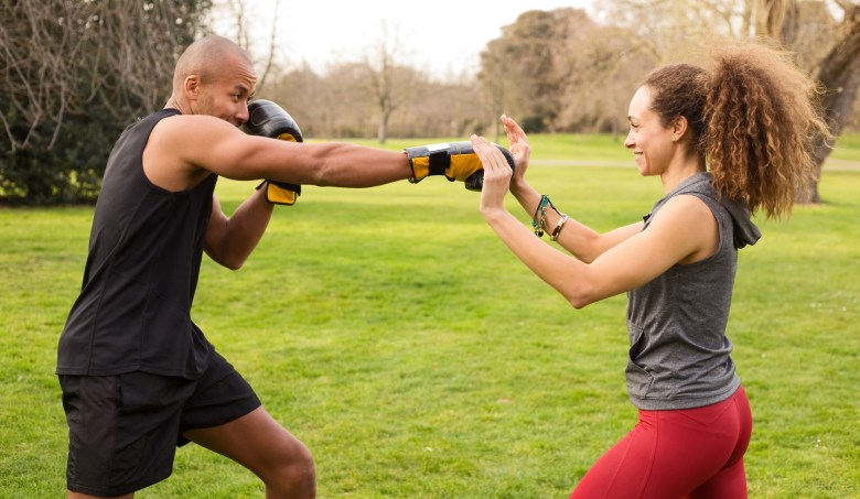 young couple training in the park boxing