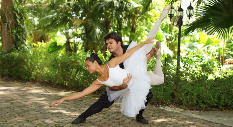 Couple performing ballet in the garden