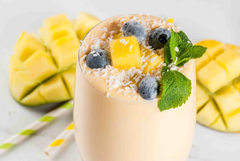 Dietary drink, breakfast. Tropical mango smoothie with fresh pie