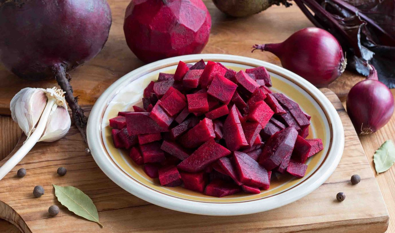 Sliced red beets on a wooden table