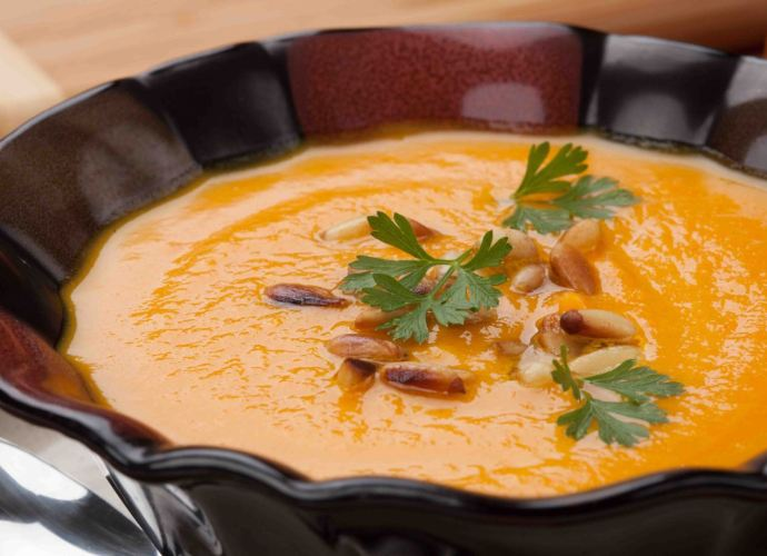 butternut squash soup with pine nuts and parsley