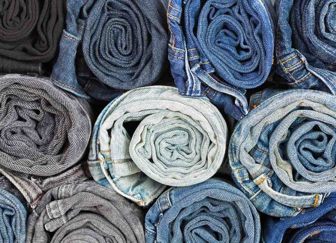 Jeans rolled to save space - packing hack