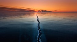 "Baikal: ""Fantastic sunrises and sunsets with the skies painted in different colors, from pink to blood-red and stones covered with bizarre pattern of ice."" bild: Alexey Trofimov"