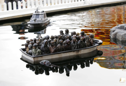 Radio controlled refugee boat game at Banksy's Dismaland theme park. Yui Mok / PA WIRE