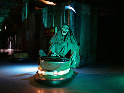 Grim reaper on bumper cars at Banksy's Dismaland theme park. Yui Mok / PA WIRE