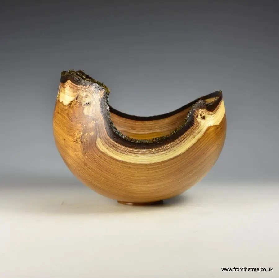 A beautiful Natural Edge Laburnum Bowl! This woodturned piece was finished with a blend of polyurethane and wax. Submitted to the gallery by George Watkins. #ArtOfTurning #woodturning