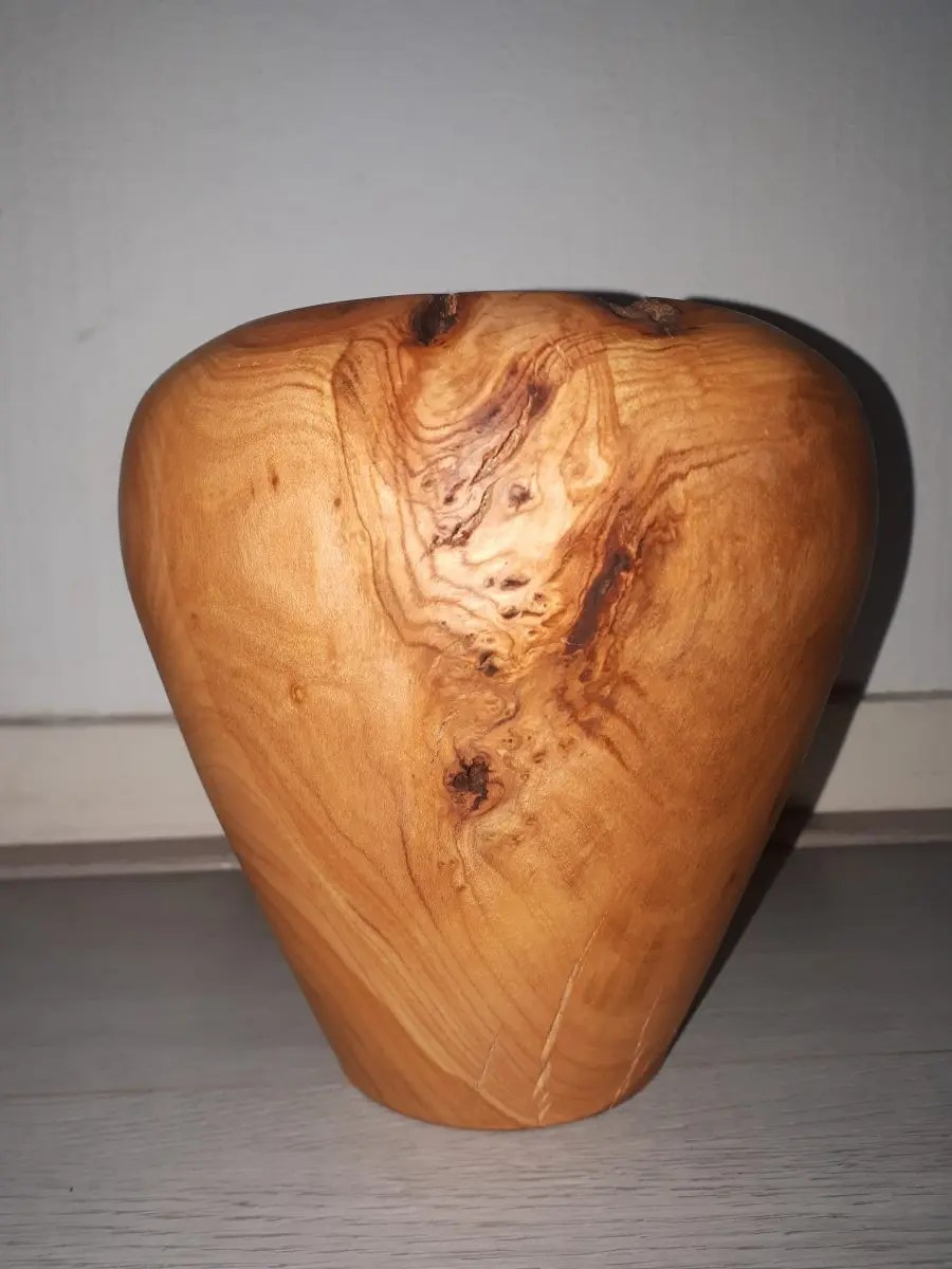 Woodturned cherry vase made on a wood lathe with nice grain.