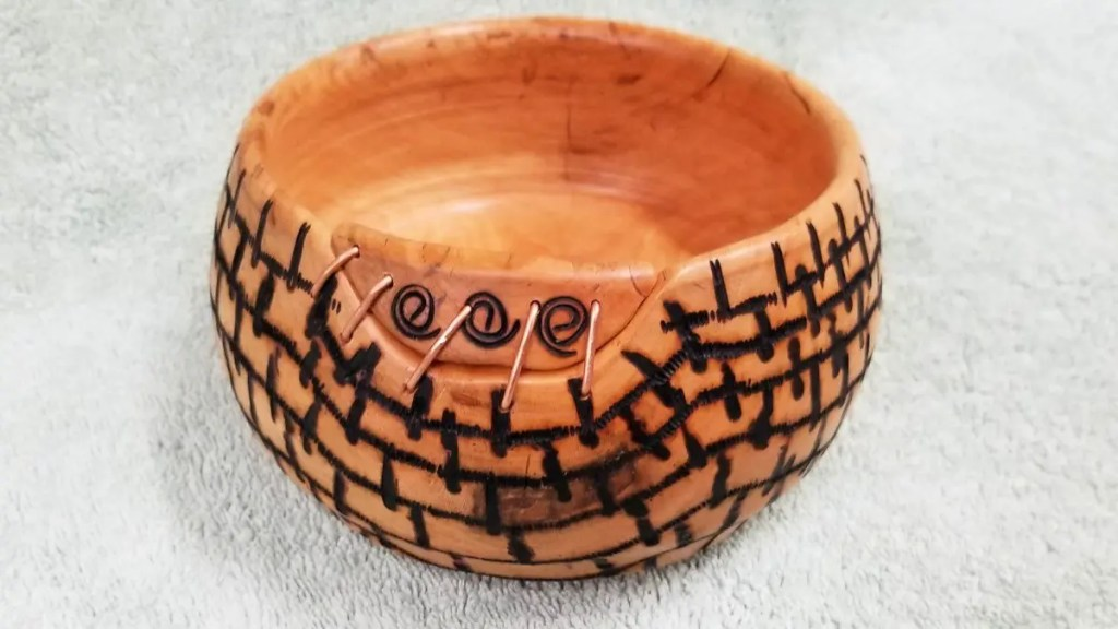 Woodturned cherry bowl with pyrography burning design