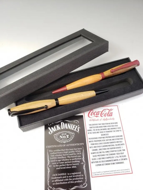 Set of Jack and Coke wood pens made from Jack Daniel's and Coca-Cola wood barrels