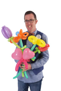 Man holding balloon flowers