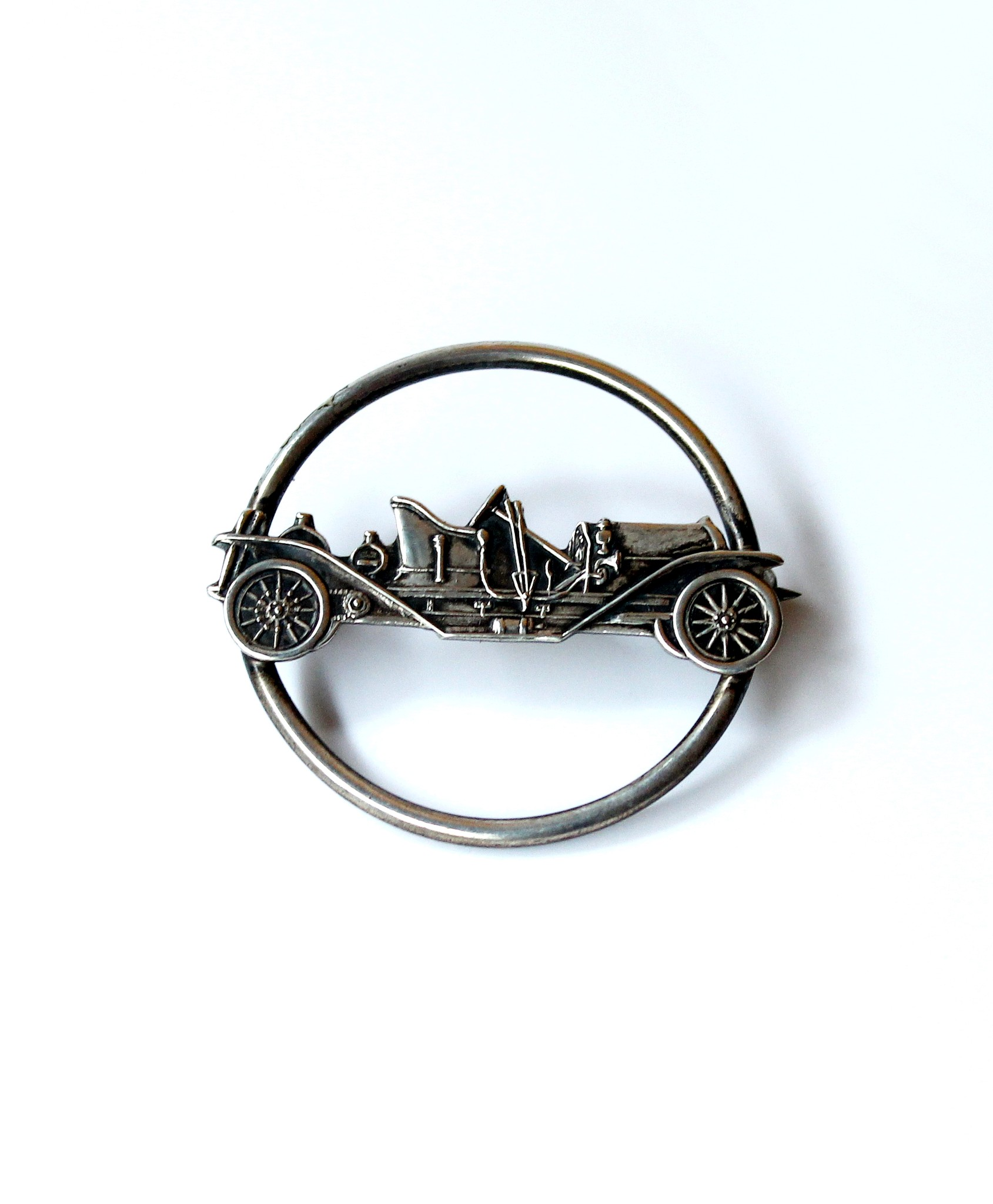Antique sterling silver motor car brooch