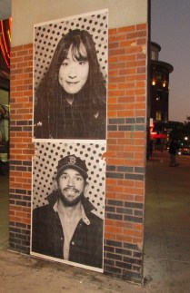 Copies of photos from Inside Out Photobooth pasted on Dartmouth Street side of Back Bay Station