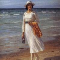 A lady walking on a beach by Niels Frederick Schiott Jensen