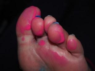 Painted toes of Roslyn Burns