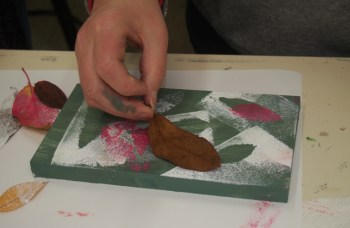 Janine Egan working with leaves
