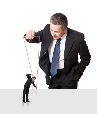 Businessman with another businessman on puppet strings
