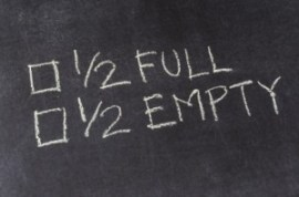 chalkboard with printing and check boxes: half full half empty