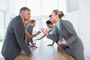 Business professionals arguing in a meeting
