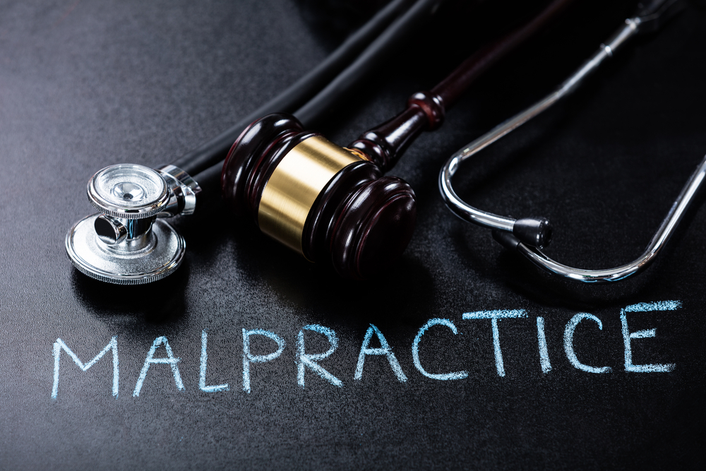 image of a stethoscope and the word malpractice