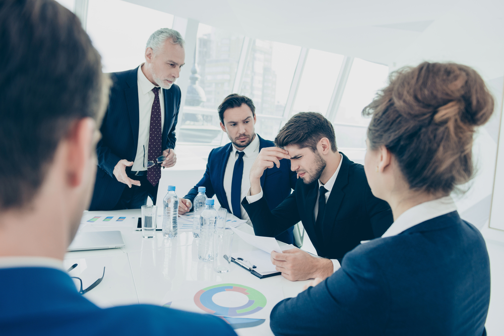 image of a group of business professionals in a stressful meeting
