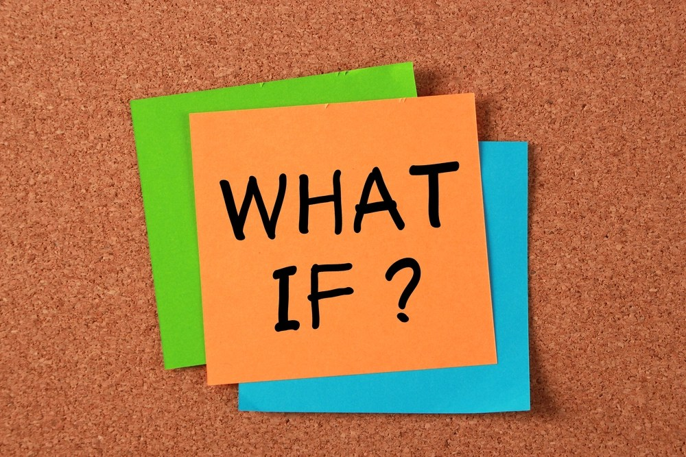 """Orange sticky note with """"What If?"""" on it"""
