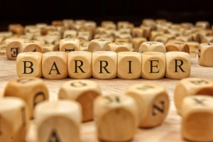 wooden tiles spelling the word barrier