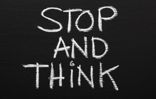 stop and think on chalkboard