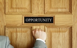 Person knocking on a door where the sign says: Opportunity""