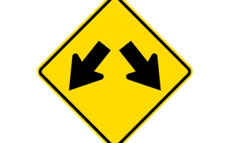 Road sign with diverging arrows